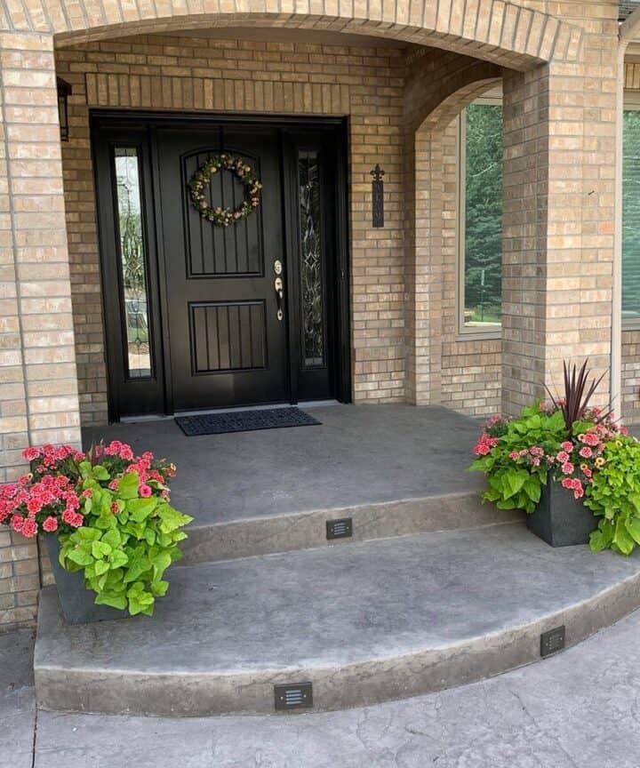 Brown Door with Flower Planters