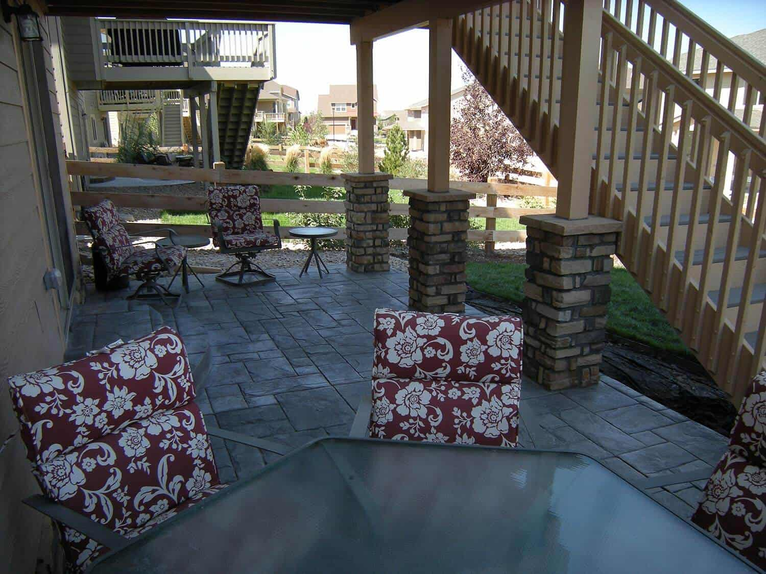 Concrete Patio with Floral Seating