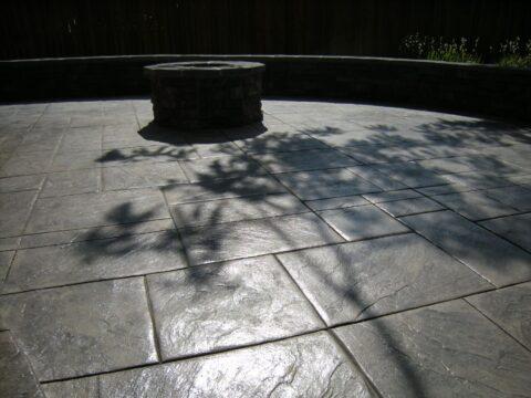 Circular stone firepit in shade