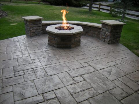 Circular stone firepit with flame 4