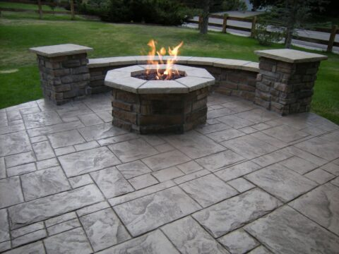 Circular stone firepit with flame 3