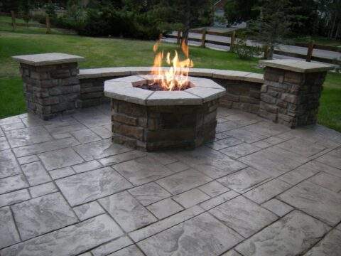 Circular stone firepit with flame 1