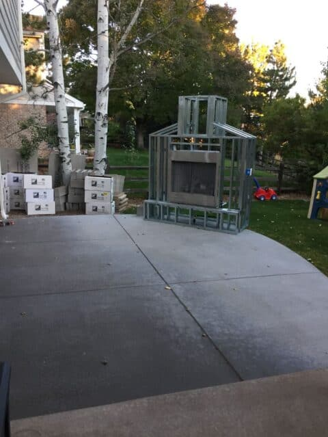 Outdoor fireplace with flame frame for build