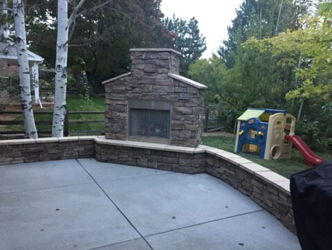 Outdoor stone fireplace with flame