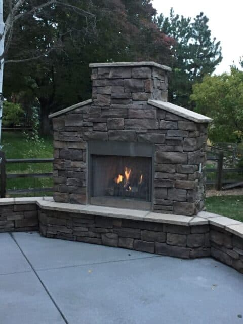 Outdoor stone fireplace with flame close up