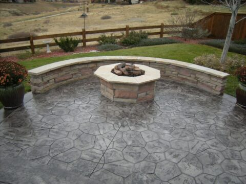 Octagon stone firepit with wood far