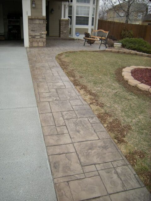Concrete pathway beside length of driveway