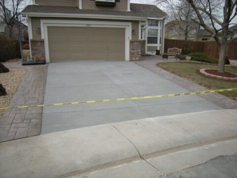 Concrete driveway with yellow tape blocking it off