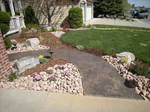 Front entry walkway with white stones on side