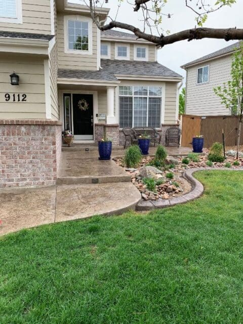 Front entry stone with blue flower pots 2