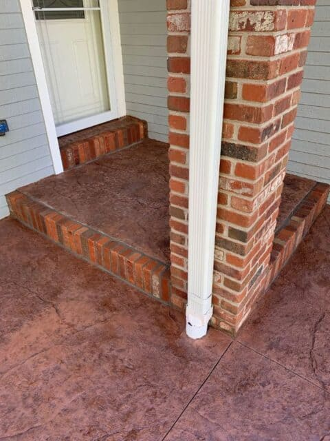 Front entry step with brick border and column