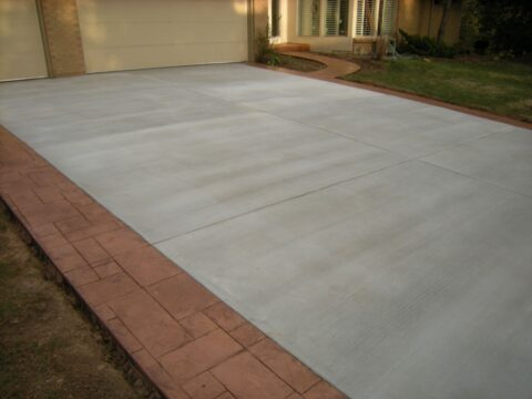 Driveway grey concrete with accent brown on border