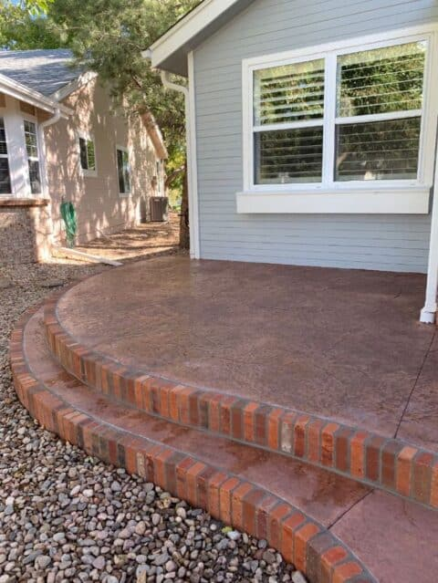 Front entry steps with brick borders
