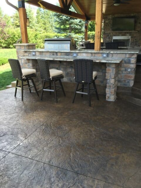 Outdoor stone counter with three chairs