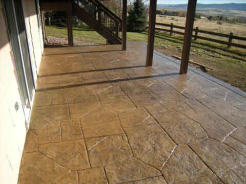 Concrete patio in random stone pattern
