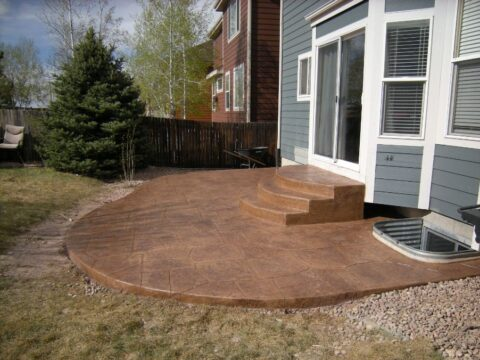 Concrete back patio and three steps