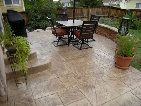 Concrete patio with table and swivel chairs