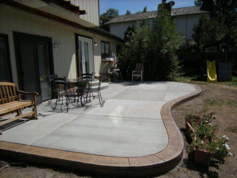 Grey concrete patio with darker border