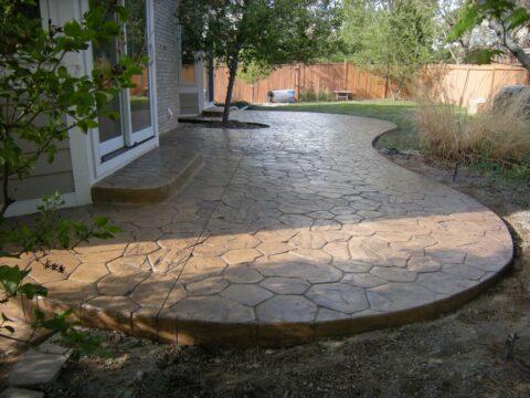 Concrete patio in walking stone pattern