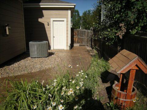 Concrete walkway from back door and wishing well