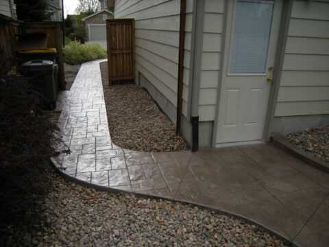 Brown curved walkway on side of house from back door