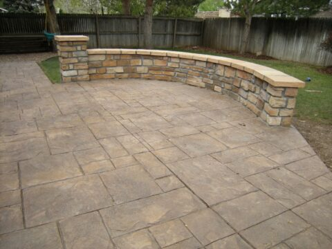 Curved concrete wall and patio