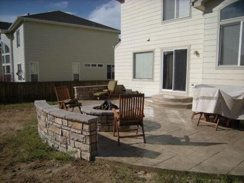 Cocnrete firepit with two chairs 2