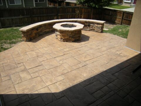 Cocnrete patio wall and octagon firepit