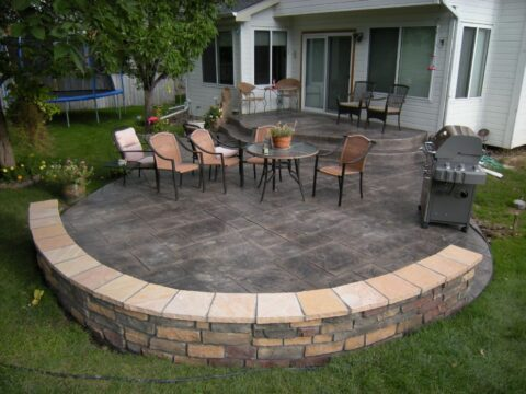 Curved concrete patio and wall with seating area