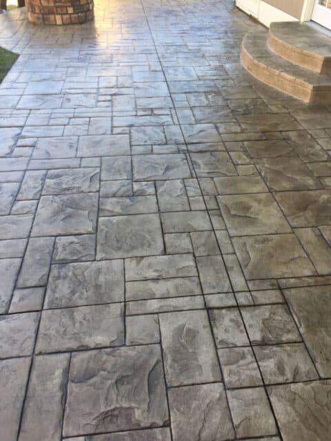 Rectangular concrete patio with stairs