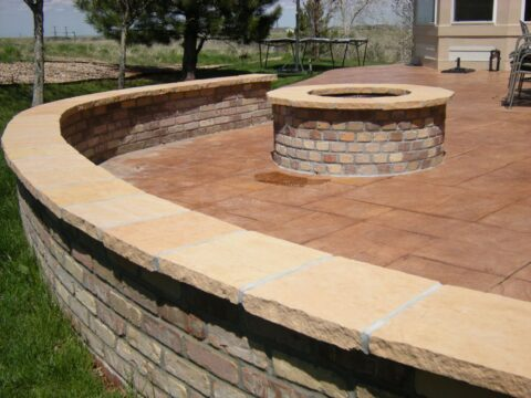 Curved concrete wall and patio with firepit