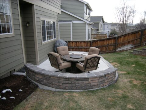 curved concrete wall with seating area